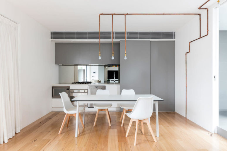 Copper tubing is continued to the kitchen and it works as pendant lamps