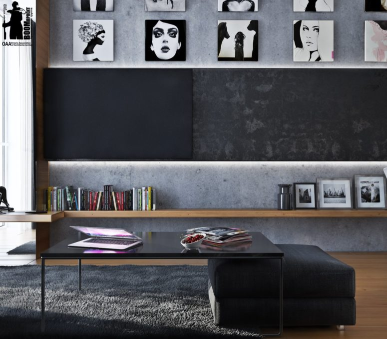 The concrete walls and a black and white gallery wall keep the decor theme