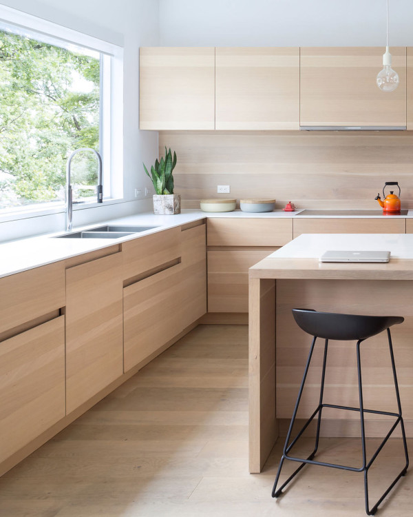 The kitchen is minimalist and is clad with white oak as the floors in the house