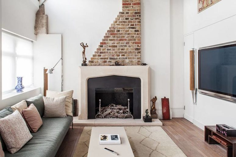 The living space nook is decorated in modern style, the fireplace is traditional