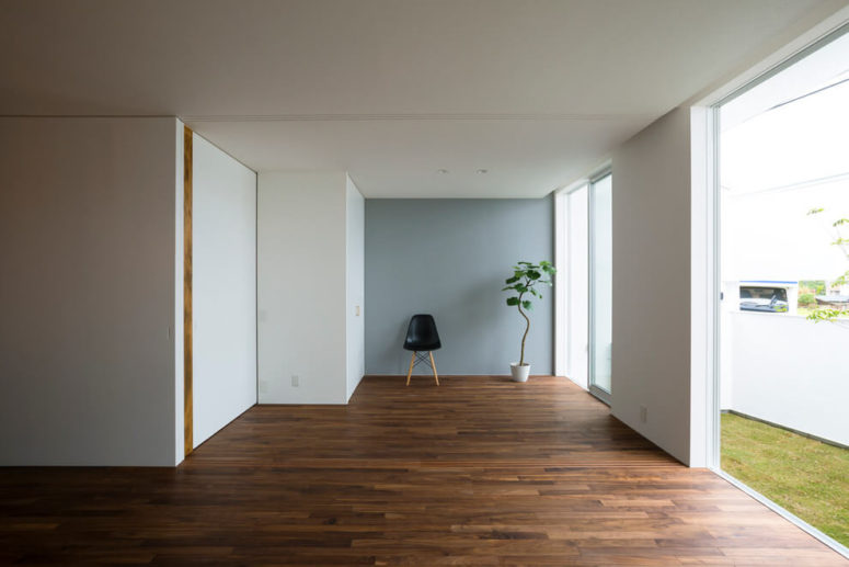 The walls are white, and beautiful wood-clad floors make the space more interesting