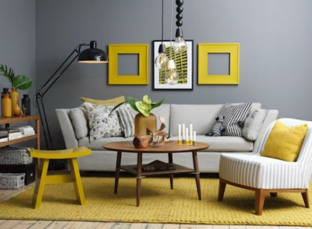 yellow and gray living room. gunmetal grey contrasts with yellow frames  a rug and stool 29 Stylish Grey And Yellow Living Room D cor Ideas DigsDigs