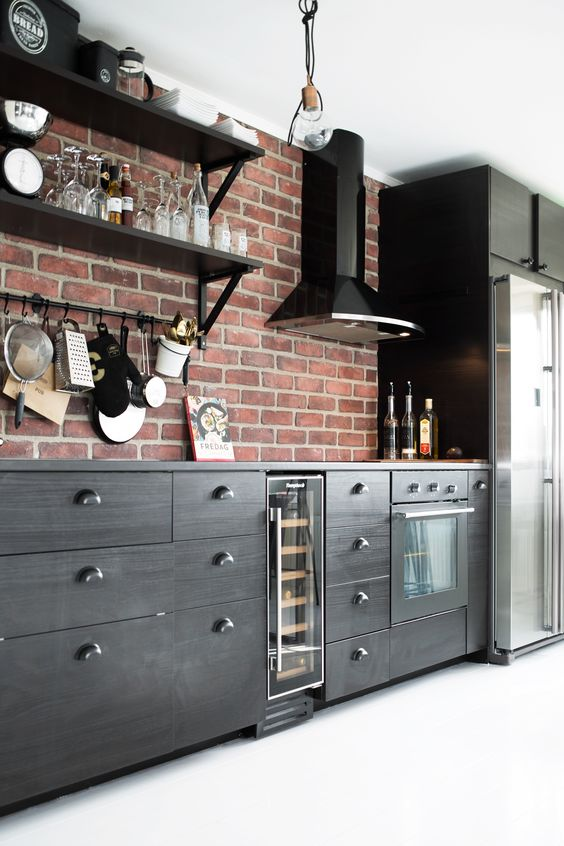modern red brick adds character to this dark kitchen
