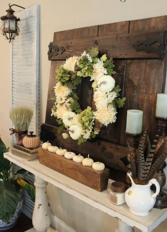pheasant feathers, white pumpkins, white silk wreath and barn door fall decor