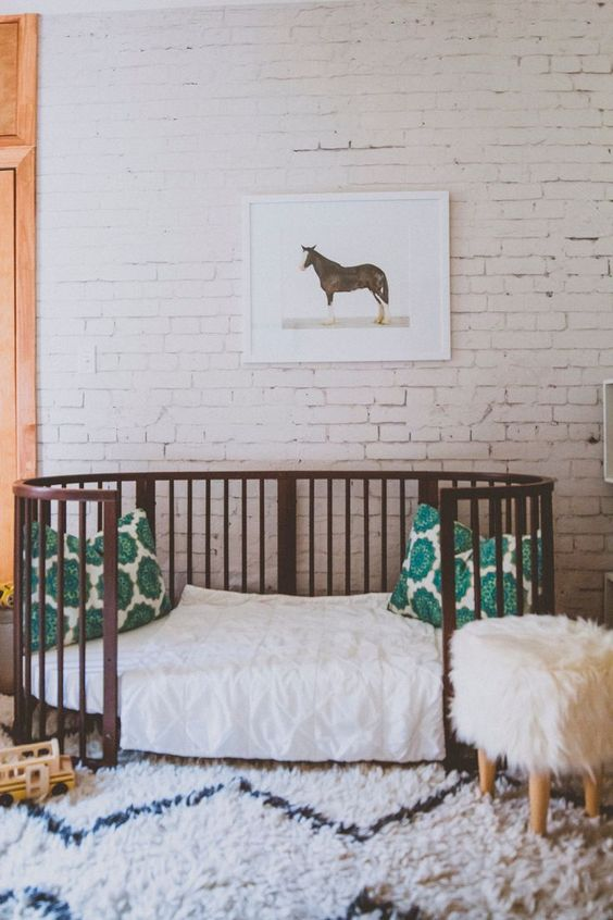 whitewashed brick walls look very calm and quiet even in a nursery