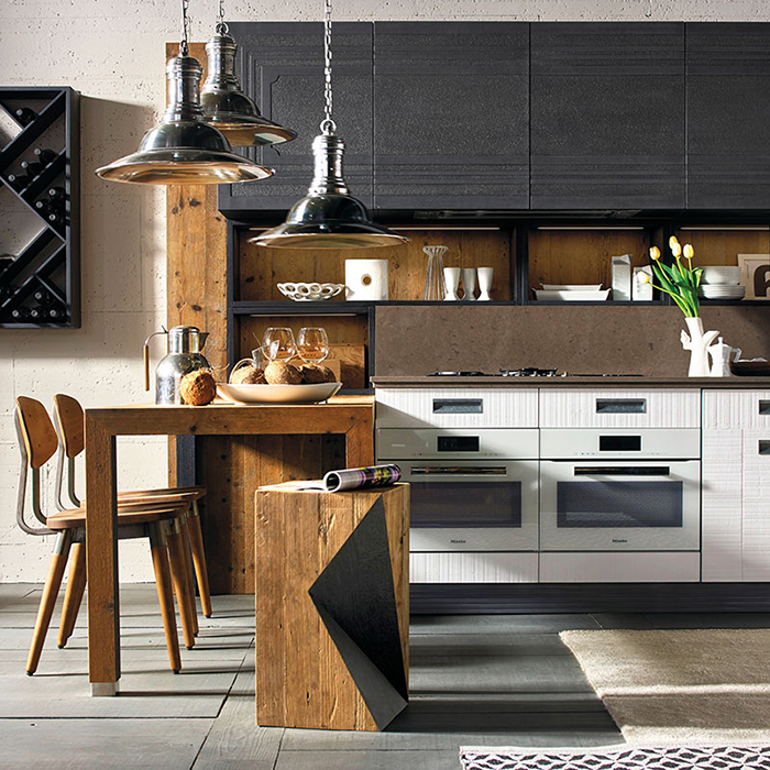 Aging wood and dark metal contrast and make the kitchen original