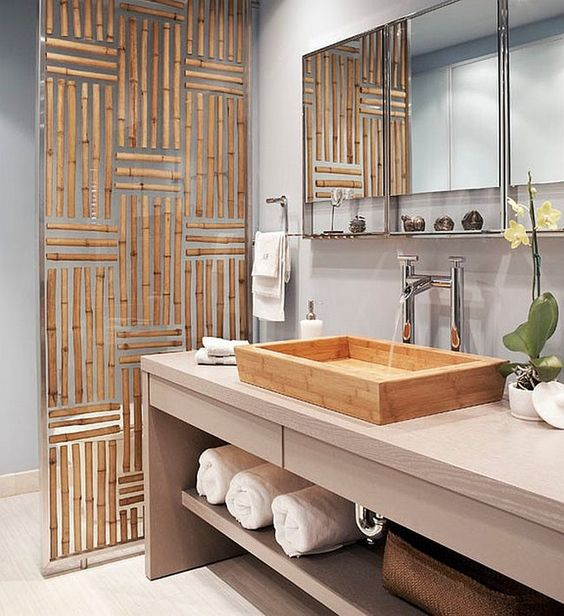 Asian-styled bathroom with light blue walls and a spa feel