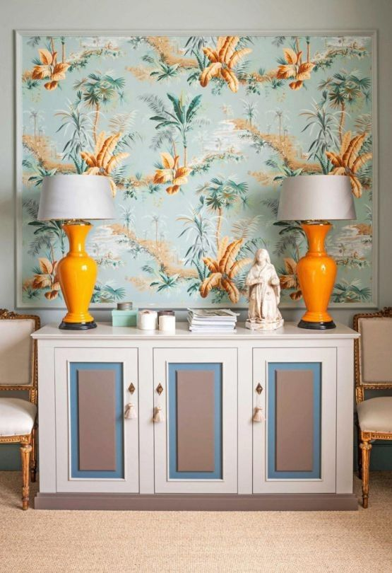 Bold wallpaper was framed as an artwork and the sideboard was designed by Chrapka to match