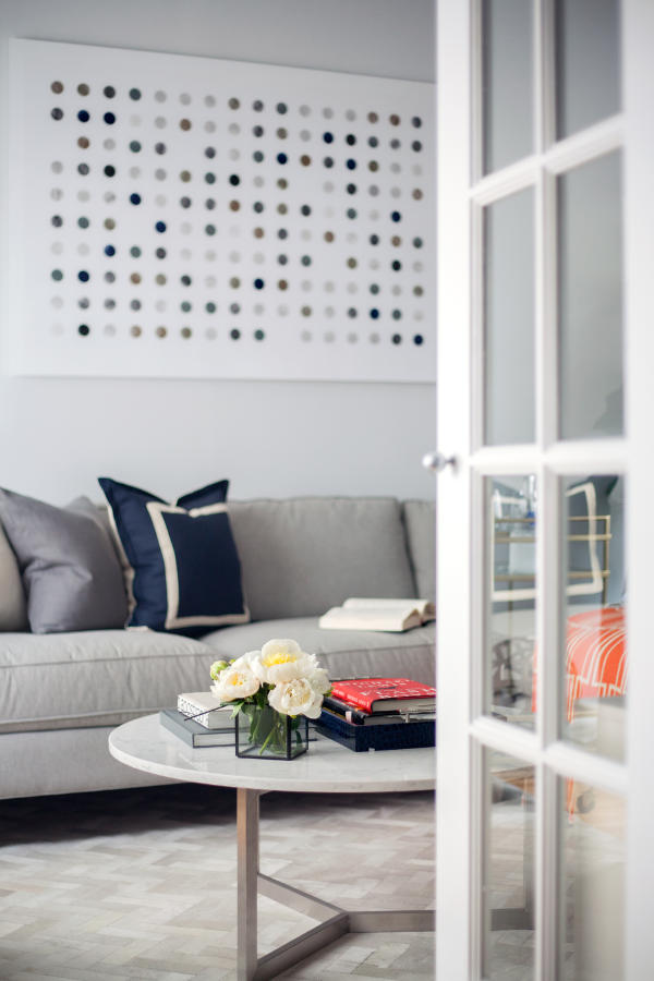Chrome furniture legs spruce up the space and keep the dove grey color scheme