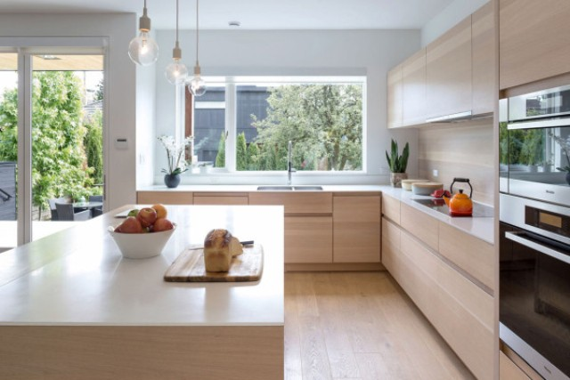 The countertops are white and the space looks totally uncluttered, sleek and modern