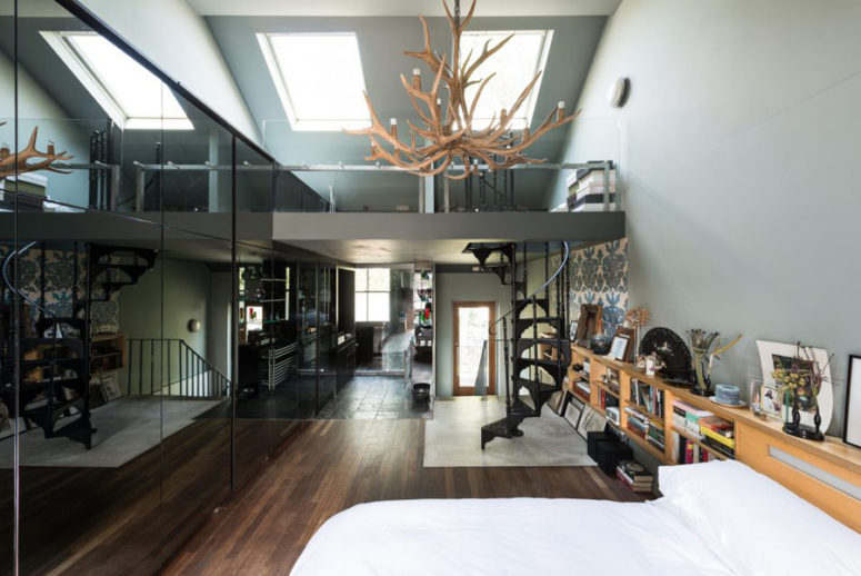 The stunning master bedroom has double-height ceilings, an en-suite bathroom and a cool staircase
