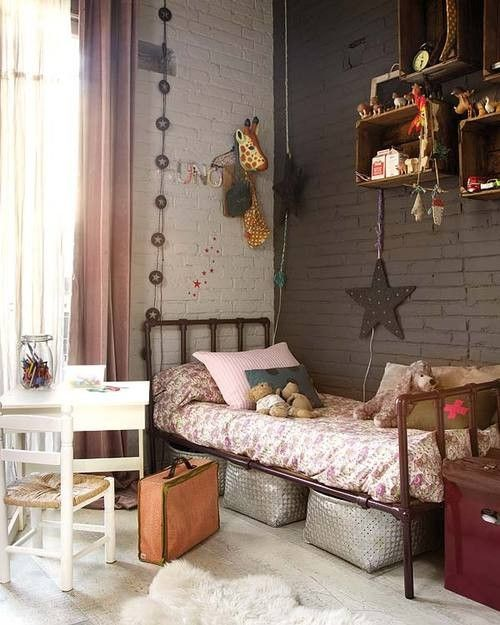 a brown and white brick wall is a nice solution for this kid's room