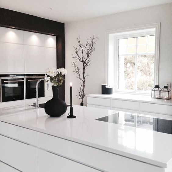 all-white kitchen with a couple of black touches looks laconically Scandinavian