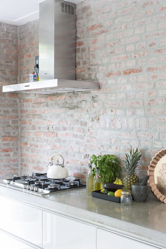 Antique Whitewashed Brick Wall Contrasts With Modern Kitchen Design