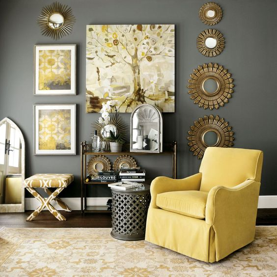 rather dark grey wall and a side table, sunny yellow armchair, artworks and a printed chair