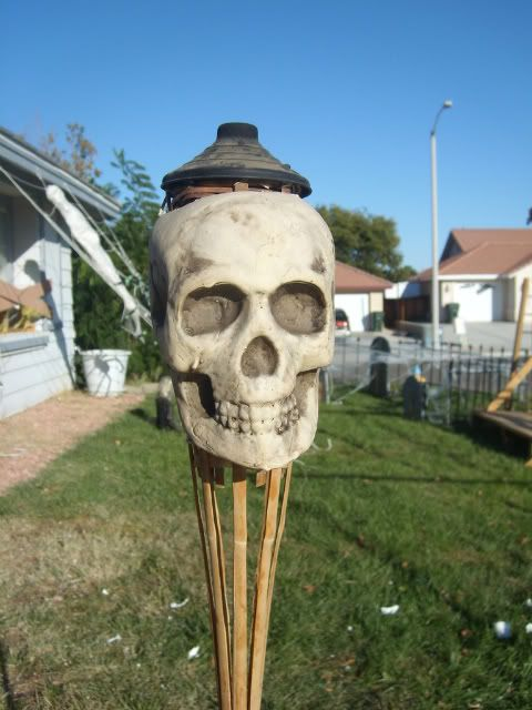 skull tiki torch for outdoor tropical Halloween decor