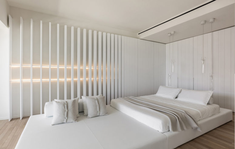 The master bedroom is decorated in white