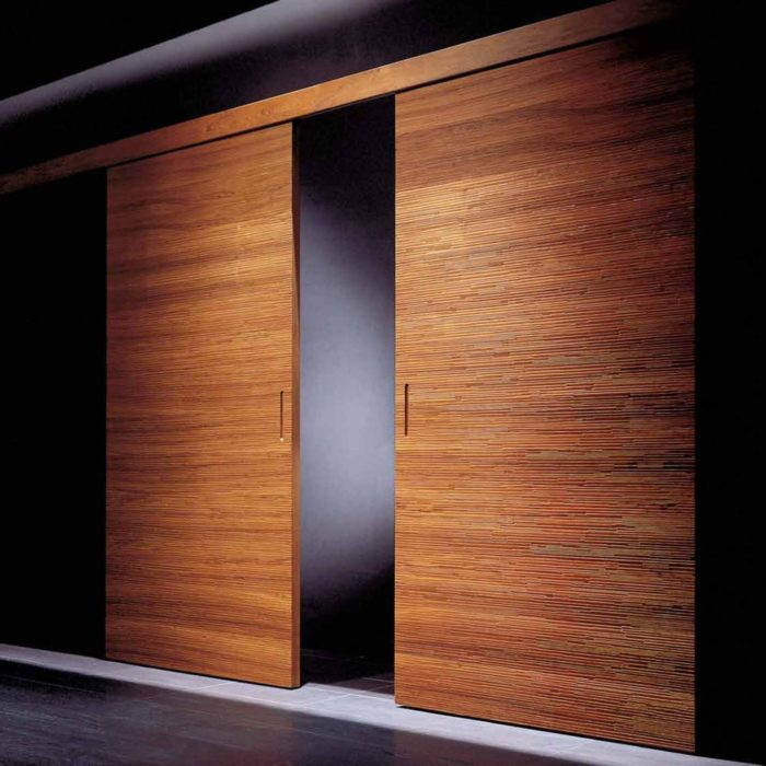 There are sliding doors for larger entrances, they have rich wood tones