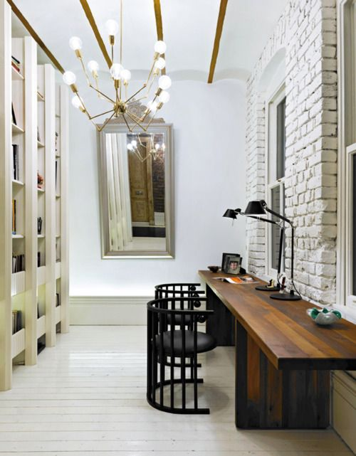 rough white brick creates a textural accent in this space
