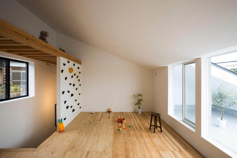 A small kids' play space is opened to a private courtyard, and there's a sliding door or window to go there