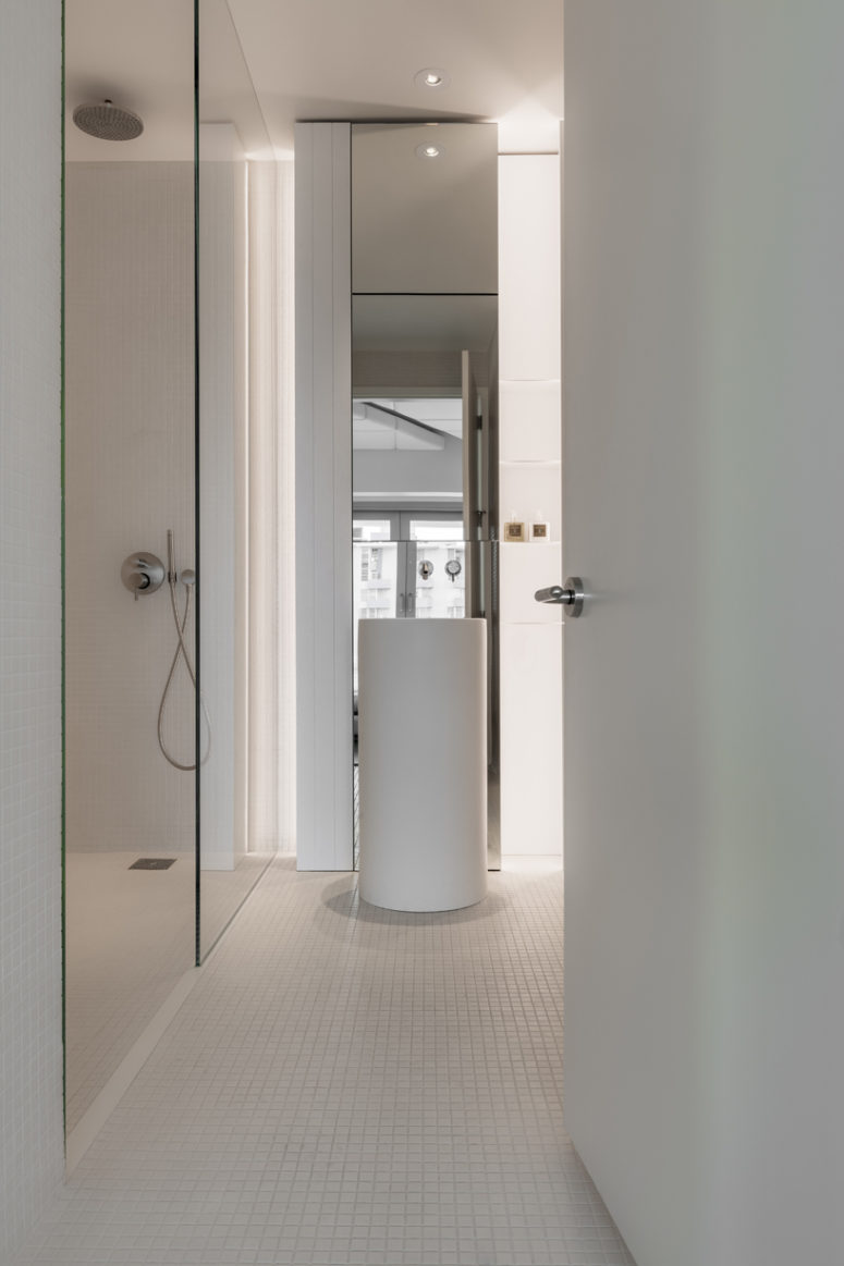 The master bathroom is decorated in minimalist white