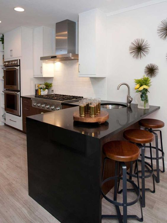 a sleek look effect is provided with a black quartz waterfall countertop, which is durable