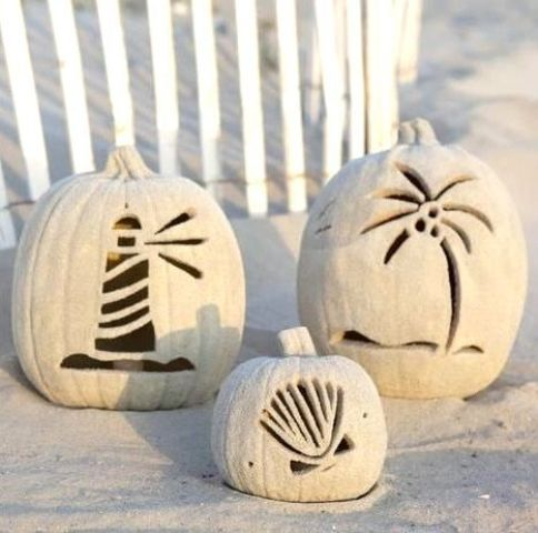 beach-inspired white pumpkins rolled in sand