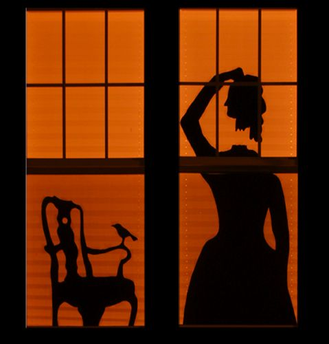 haunted house-inspired Halloween window silhouettes
