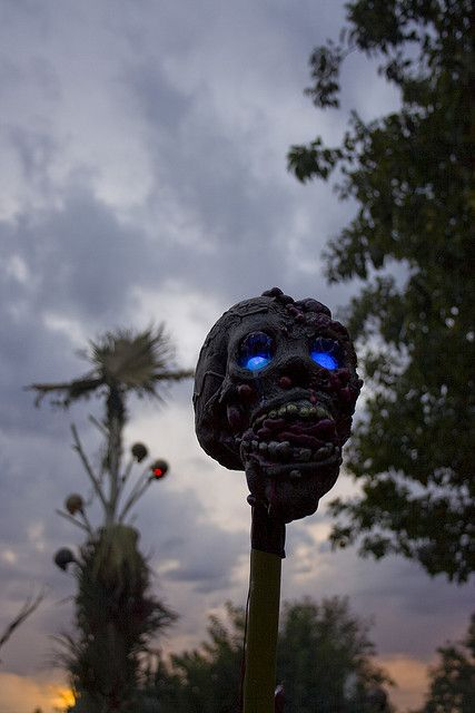 tiki torch shaped as a scary zombie head