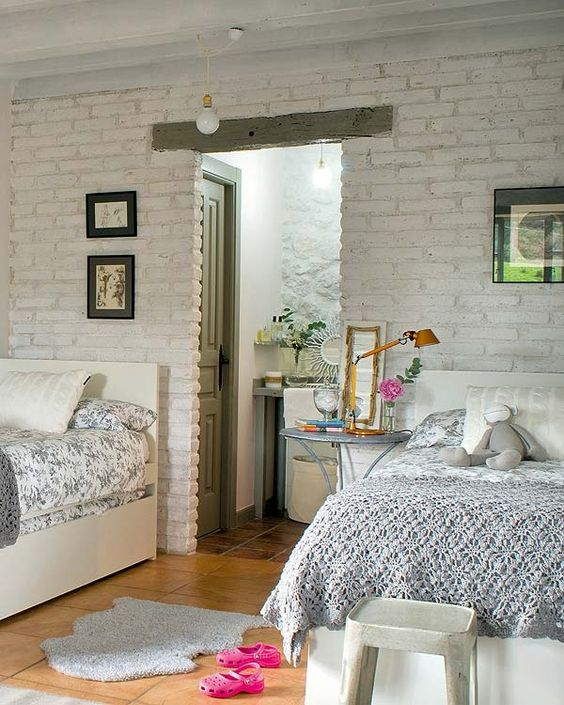 white brick wall for a shared girls' bedroom