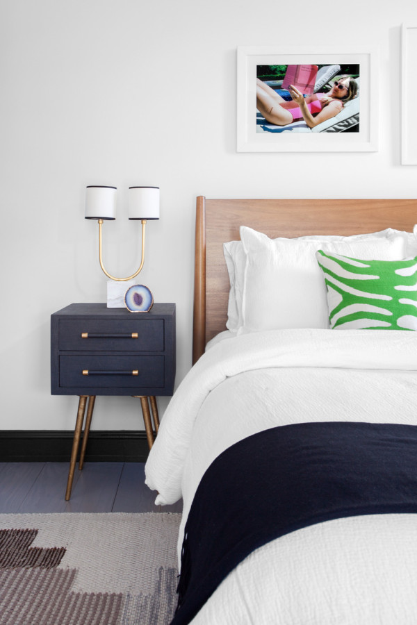 Small nightstands are mid century modern, with gold touches and legs