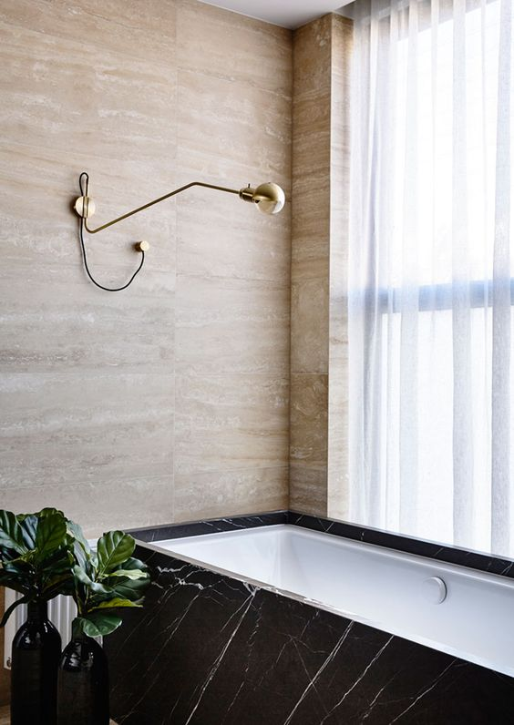 Stone and marble of various shades make this bathroom cool and refined