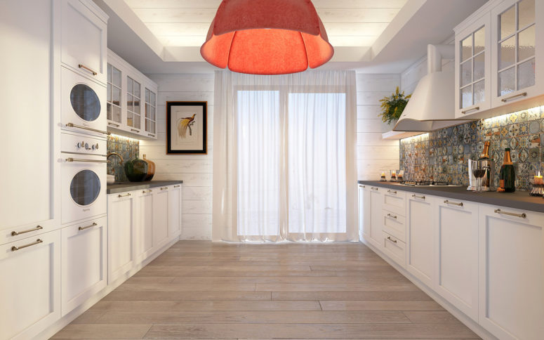 The kitchen is rather traditional, all white with soft touches