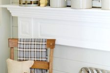 09 neutral fall mantel incorporating farmhouse style with vintage wooden chair, tobacco baskets, and burlap pillows