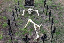 09 set up a skeleton head, arms, and legs as if he's relaxing on his final resting spot