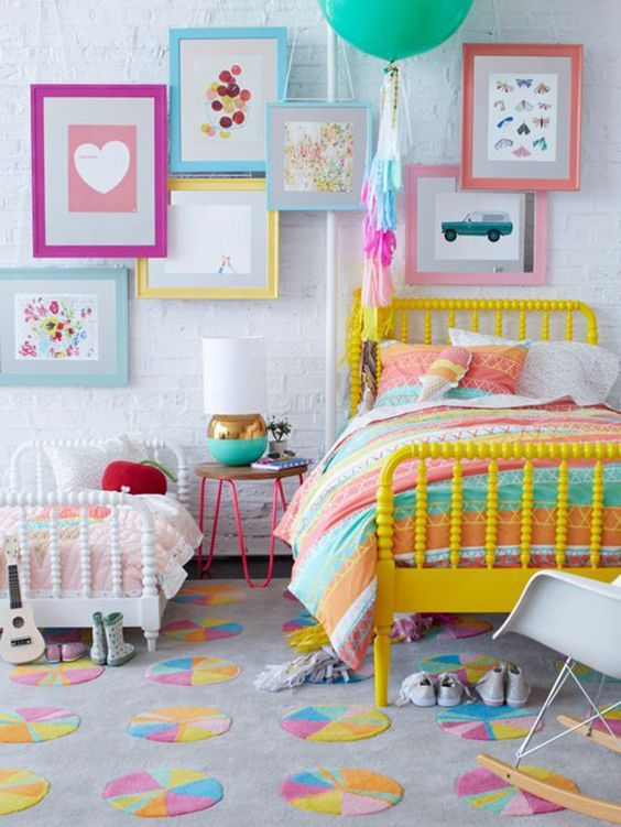 shared girls' room with lots of color and a whitewashed headboard wall