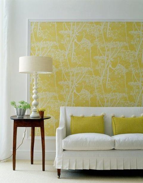 stick fabric on the wall with liquid starch, frame it with trim board to make it look like large wall art