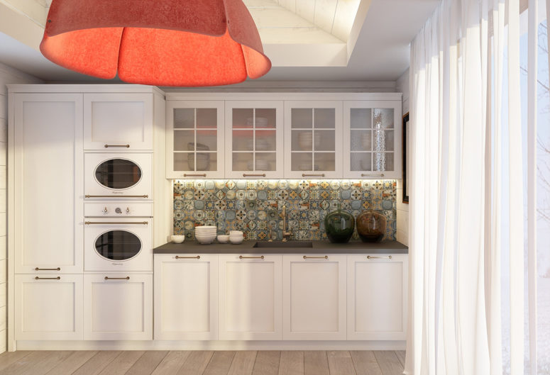 Only a bold red lamp and a mosaic backsplash stand out