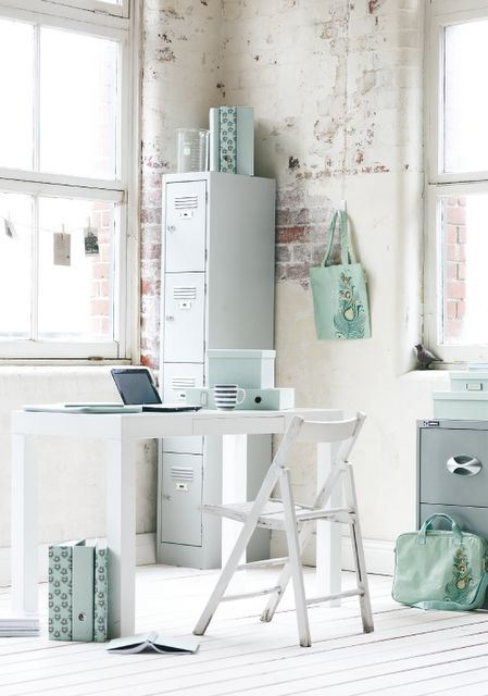 airy and light home office with uneven brick walls and aqua accents