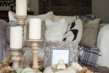 10 coffee table display with silk flowers, pillar candles and white pumpkins