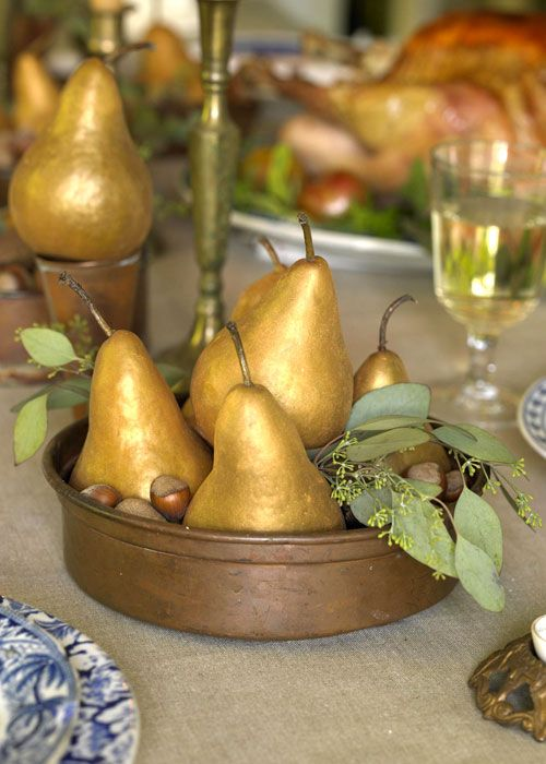 gold pear and acorns centerpiece in a bowl