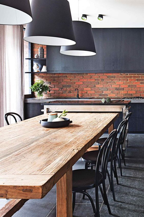 masculine kitchen of dark grey with modern red brick clad