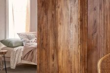 10 slatted screen room divider adds a natural touch to the room decor