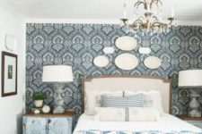 10 starch blue patterned fabric to the headboard wall to highlight the Provence style