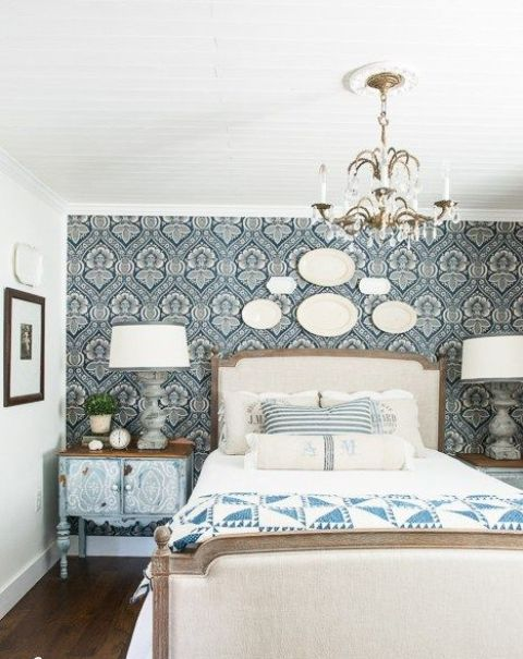starch blue patterned fabric to the headboard wall to highlight the Provence style