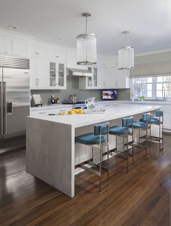 white marble-looking granite is durable and bring a modern vibe to these shaker cabinets