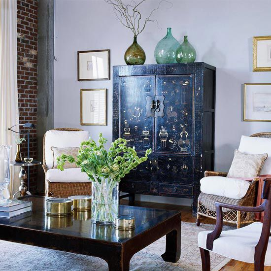 antique Chinese cabinet and coffee table pop up in a light grey backdrop with their yellow details