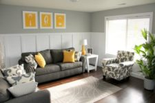 11 charcoal grey sofa and chair, yellow pillows and art pieces