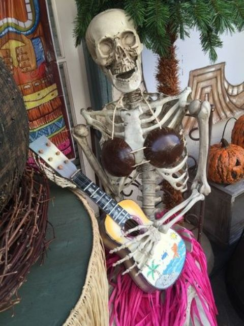 lady skeleton with a guitar is a whimsy Halloween decor idea