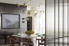 11 narrow framed glass screens add to the decor and separate areas without looking too bulky